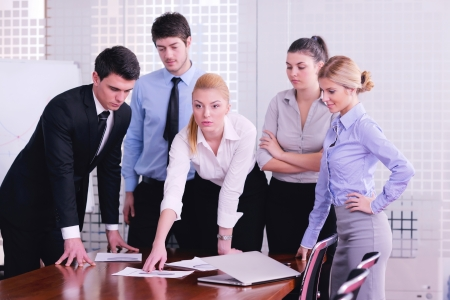 Group of happy young  business people in a meeting at office Stock Photo - 18319317