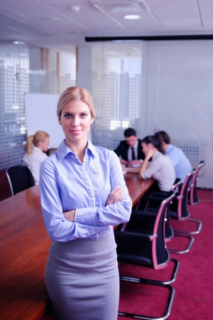 business woman  with her staff,  people group in background at modern bright office indoors Stock Photo - 18320014