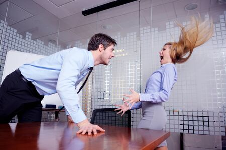 Angry business man screaming at employee in the office photo
