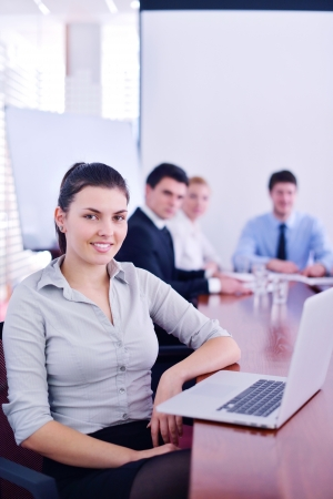 business woman  with her staff,  people group in background at modern bright office indoors Stock Photo - 18320028