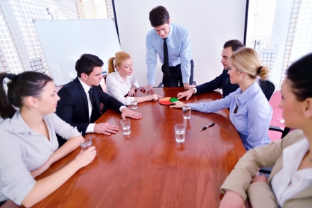 Group of happy young  business people in a meeting at office Stock Photo - 18320060