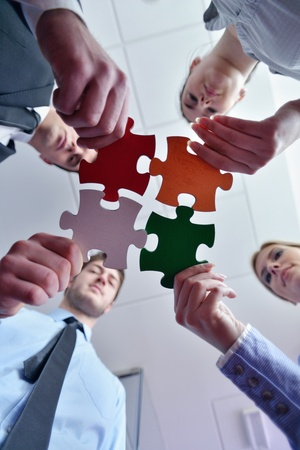 join the team: Group of business people assembling jigsaw puzzle and represent team support and help concept