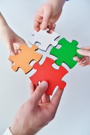 jigsaws: Group of business people assembling jigsaw puzzle and represent team support and help concept