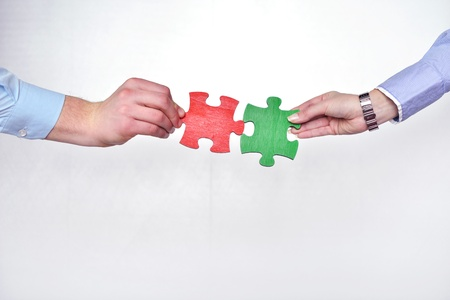 love strategy: Group of business people assembling jigsaw puzzle and represent team support and help concept
