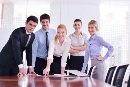 business group: Group of happy young  business people in a meeting at office Stock Photo