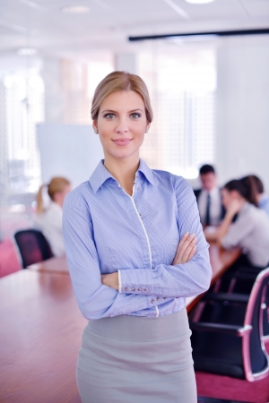 business woman  with her staff,  people group in background at modern bright office indoors Stock Photo - 18340769