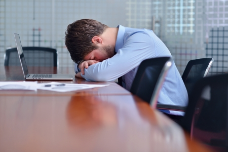 depressed man: Young business man with problems and stress in the office Stock Photo