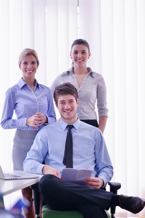 Group of happy young  business people in a meeting at office Stock Photo - 18341073