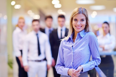 business woman  with her staff,  people group in background at modern bright office indoors Stock Photo - 18340579
