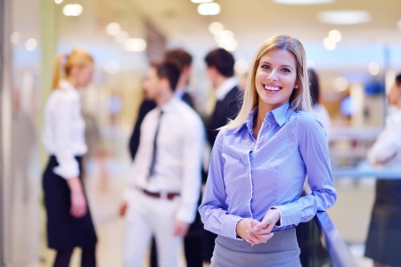 business woman  with her staff,  people group in background at modern bright office indoors Stock Photo - 18341074