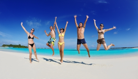 friendship day: group of happy young people have fun and joy at the  white sand  beach on beautiful summer  day