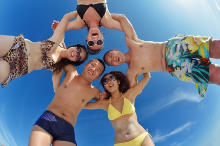 group of happy young people have fun and joy at the  white sand  beach on beautiful summer  day Stock Photo - 18487019