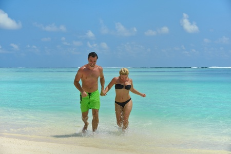 happy young  couple at summer vacation have fun and relax at beautiful sunny  day photo