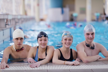 happy children kids group  at swimming pool class  learning to swim Stock Photo - 19559515