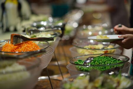 catering buffet food indoor in luxury restaurant with meat colorful fruits  and vegetables photo