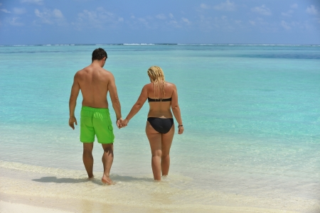 happy young  couple at summer vacation have fun and relax at beautiful sunny  day on beach photo