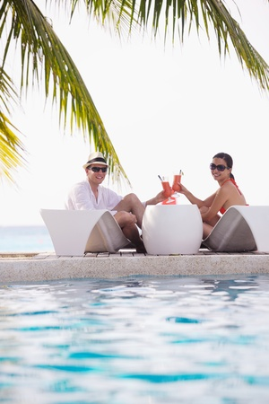 resort life: happy young romantic couple in love have fun running and relaxing on beautiful beach Stock Photo