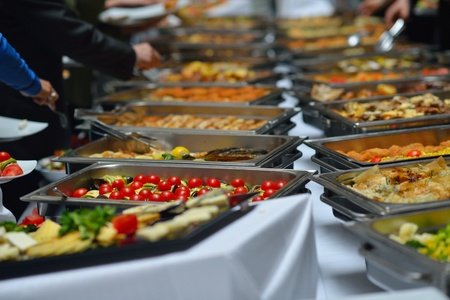 catering service: people group catering buffet food indoor in luxury restaurant with meat colorful fruits  and vegetables