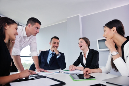 job training: Group of happy young  business people in a meeting at office Stock Photo