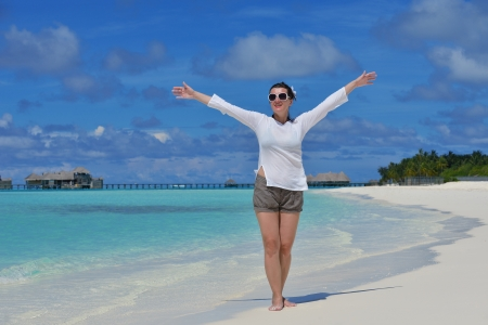 happy young woman on summer vacation on beautiful tropical beach have fun and relax photo