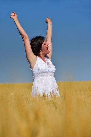 spreading arms: healthy Happy  young woman with spreading arms, blue sky with clouds in background  - copyspace