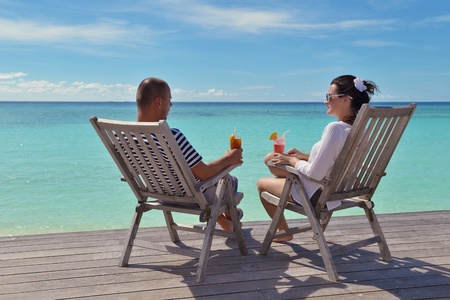 happy young couple relax and take fresh drink at summer vacation photo