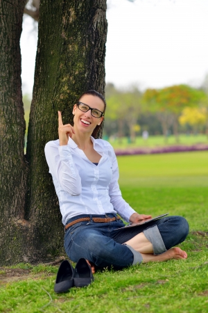 Beautiful young student  woman study with tablet in park photo