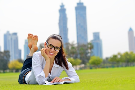 Young student woman reading a book and study in the park Stock Photo - 20822784