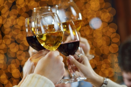 champagne toast: Celebration. Hands holding the glasses of champagne and wine making a toast.