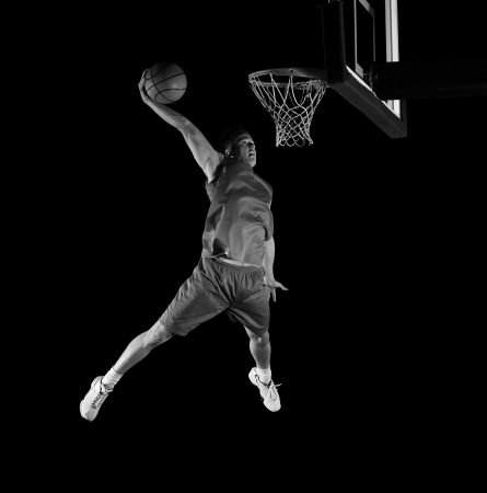 basketball net: basketball game sport player in action isolated on black background