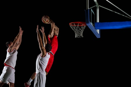basketball team: basketball game sport player in action isolated on black background