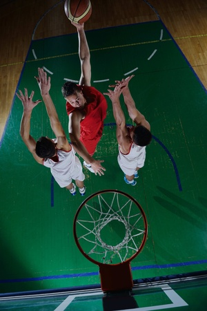 moving activity: basketball game sport player in action isolated on black background