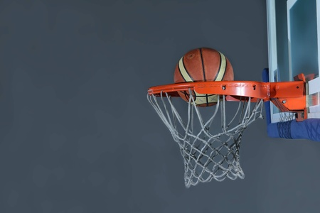 street shots: Basketball ball,  board and net  on grey  background in gym indoor Stock Photo