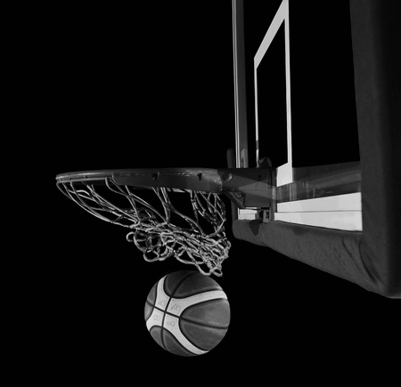 street shots: Basketball ball, board and net on black background in gym indoor Stock Photo