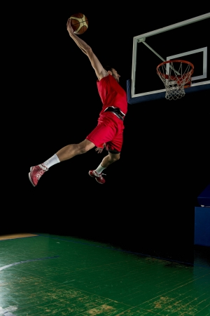 action sports: basketball game sport player in action isolated on black background
