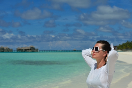 happy young woman on summer vacation on beautiful tropical beach have fun enjoy and relax photo