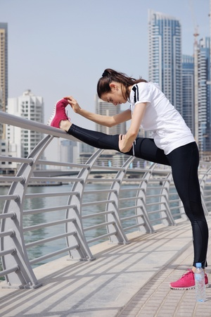 Young beautiful  woman jogging and running  on morning at  park in the city  Woman in sport outdoors health and fitness concept photo