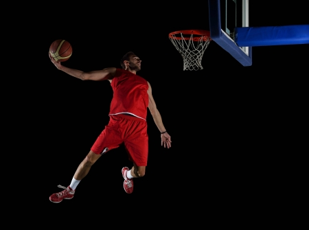 basketball game sport player in action isolated on black background Reklamní fotografie - 21403410