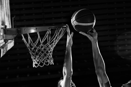 slam: basketball game sport player in action isolated on black background