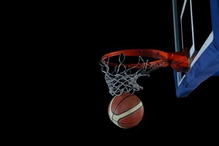 basketball net: Basketball ball,  board and net  on black background in gym indoor