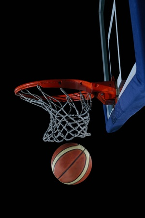 dunk: Basketball ball,  board and net  on black background in gym indoor