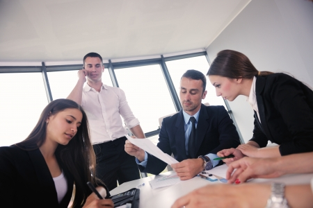 Group of happy young  business people in a meeting at office Stock Photo - 22127790