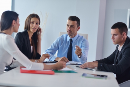 Group of happy young  business people in a meeting at office Stock Photo - 22128584