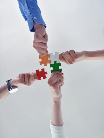 creative thinking: Group of business people assembling jigsaw puzzle and represent team support and help concept