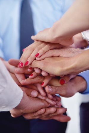 business people group joining hands and representing concept of friendship and teamwork,  low angle view photo