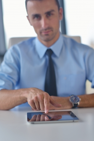 close-up of human hand  business man using tablet compuer at office photo