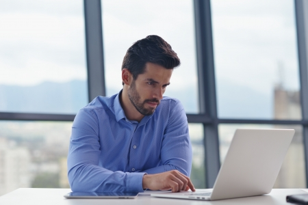 good: happy young business  man work in modern office on computer Stock Photo