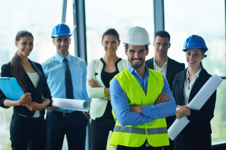 business people group on meeting and presentation  in bright modern office with construction engineer Stock Photo - 22106184