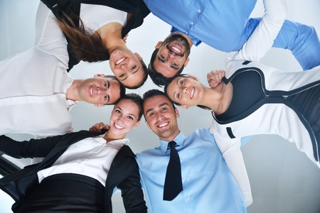 corporate group: business people group joining hands and representing concept of friendship and teamwork,  low angle view