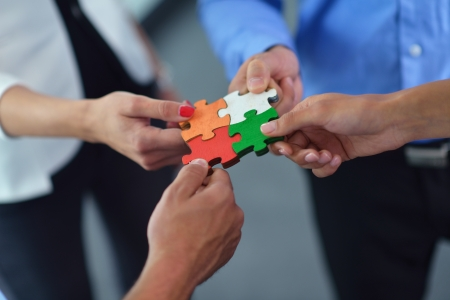 group communication: Group of business people assembling jigsaw puzzle and represent team support and help concept